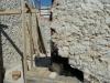 Chiusura di una canna fumaria in muratura utilizzaando materiale di recupero