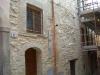 Finitura parete in pietra con malta storica